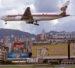 AMGB7J Plane landing at Kai Tak old airport Hong Kong SAR. Image shot 1998. Exact date unknown.